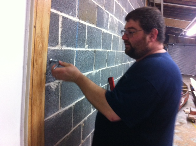 Our man Norman helping to set in wall anchors at the PVRC.