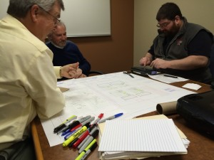 Atlantic employees Mike Gross (center),  and Norm Fortini (right) with the firm's kaizen facilitator.